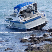 Who pays for injuries suffered in a boating accident in Miami, Florida?