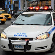 A Young Girl is Left Injured After Engaging in an Accident with a NYPD Officer While Crossing the Road
