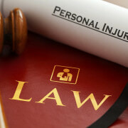 Can an injured construction worker sue their employer for compensation in Wyoming?