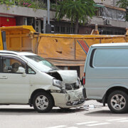 Who pays for the injuries suffered in an accident that occurs in a company vehicle?