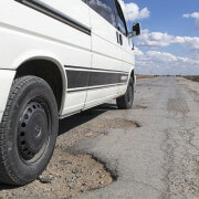Who is responsible when a pothole causes an accident in Kendall, Florida?