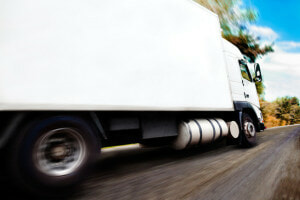 Who is liable for an accident that was caused by a truck driver who was texting in Texas?